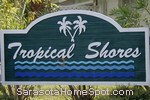 sign in front of Tropical Shores in Sarasota