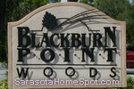 sign in front of Blackburn Point Woods in Osprey