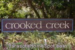 sign in front of Crooked Creek in Sarasota