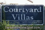 sign in front of Courtyard Villas in Sarasota