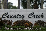 sign in front of Country Creek in Sarasota