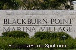 sign in front of Blackburn Point Marina Village in Osprey
